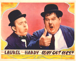 Laurel and Hardy thumb a fire